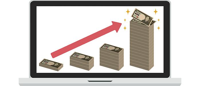 ノートパソコンに映る売上グラフ